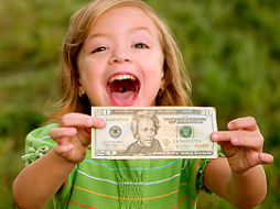 young girl holding up money